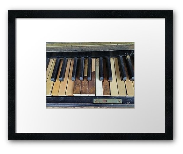 banged up piano framed